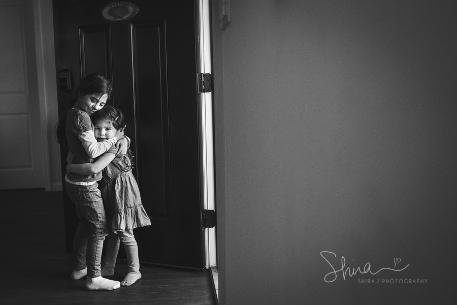 two sisters hugging photo by long island family photographer