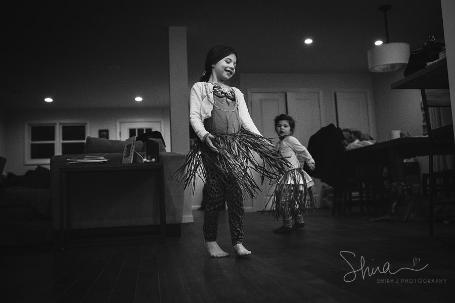 girl dancing hula with a hula skirt for LI Family Photographer
